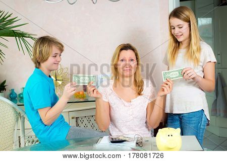 Mother Giving Her Children Pocket Money