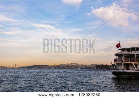 Scenic view with clouds on sunset sky over Bosporus with big ship in Istanbul Turkey