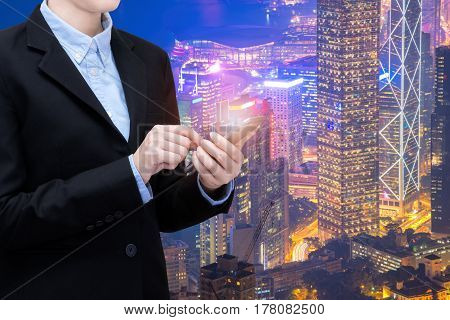 Young business woman is using smart technology of internet of things in smart city for global business connection. Photo design for smart city and smart technology internet of things concept.