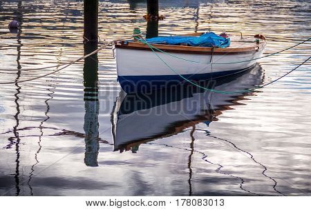 white boat with a water reflection, location - Wellington, North Island, New Zealand
