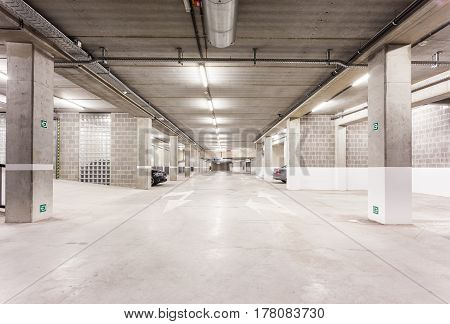 Underground park of a mall with columns and ventilation ducts