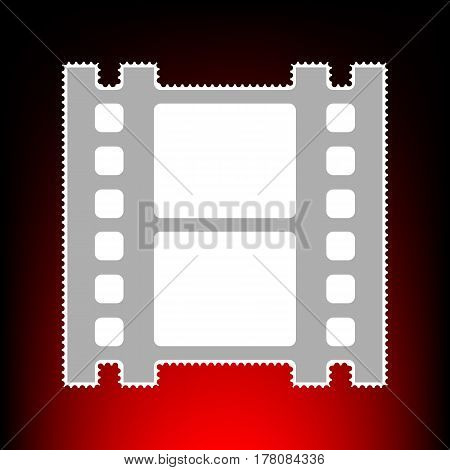 Reel of film sign. Postage stamp or old photo style on red-black gradient background.