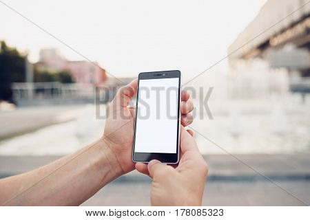 Making selfie POV. Hands holding and touch on blank smartphone with clipping path for screen
