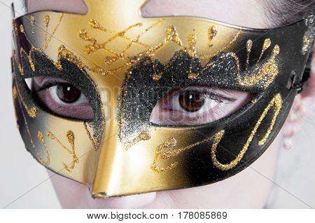 Beautiful Brown Eyes In A Golden Theatrical Mask