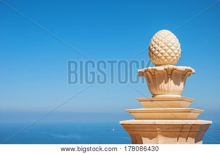 Beautiful architectural fragment against the blue sky and the sea