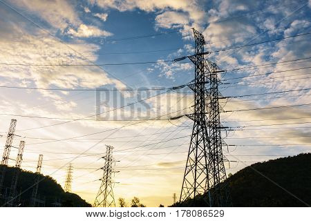 High voltage towers on skies background Transmission line tower.