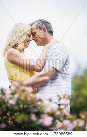 Happy couple hugging outside