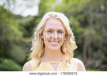 Cute woman smiling at camera outside