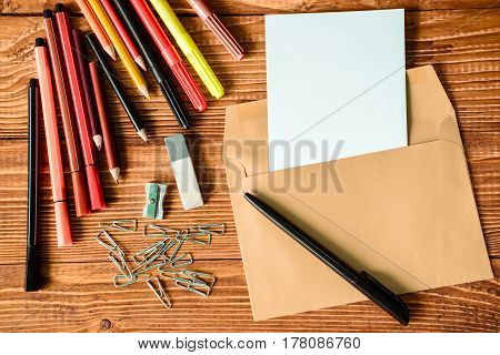 color pancils , note book, back to school background, top view