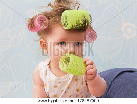 Funny Little Girl With Curlers On Her Hair.
