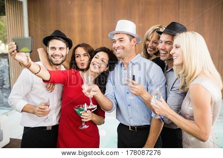 Group of friends taking selfie at the party