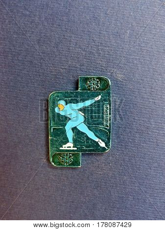 USSR - CIRCA 1980: Badge with a picture of skater and the inscription
