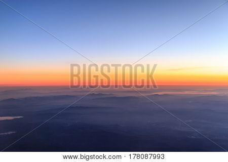 View of Aegean region of turkey from sky with mist on mountains
