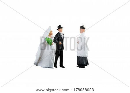 Close up of Miniature people wedding bride and groom couple isolated with clipping path on white background.Elegant Design with copy space for placement your text mock up for love and wedding concept