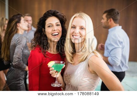 Portrait of beautiful women having drinks at the party