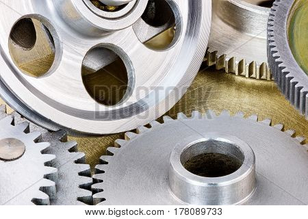 Industrial Metal Scratched Background With Pulleys And Cogwheels