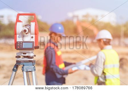 Construction engineer and foreman worker check fabrication drawing at construction site for new Infrastructure construction project. photo concept for engineering work.