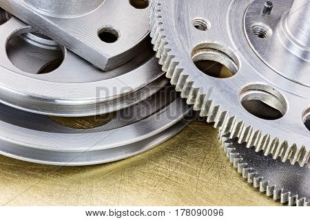 Metal Gear Cogwheels And Pulleys For Industry On Scratched Brass