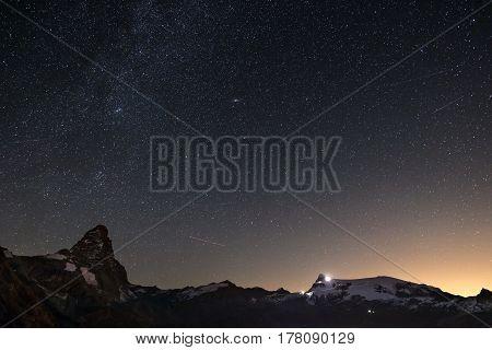 Wonderful Starry Sky Over Matterhorn (cervino) Mountain Peak And Monte Rosa Glaciers, Famous Ski Res