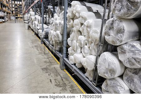 much plastic film is in stock in a modern shop