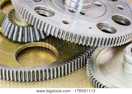 Set Of Industrial Gear Cogwheels On Scratched Brass Background