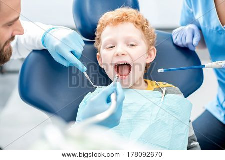 Young boy during the dental procedure at the dental office