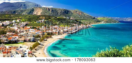 Greek holidays - beautiful Kalyves village with turquoise sea. Crete island