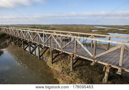 Piedras river marshlands footbridge close to El Rompido Huelva Spain