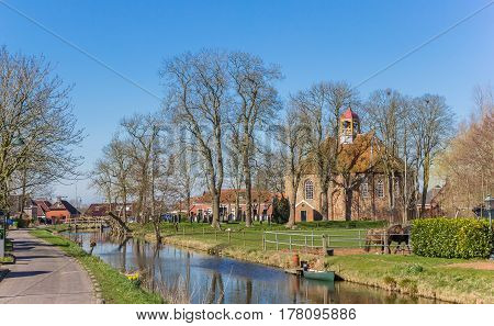 Medieval Church Along A Canal In Thesinge