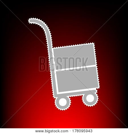 Hand truck sign. Postage stamp or old photo style on red-black gradient background.