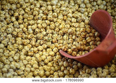 Products of nature as a background - bunch of chickpeas with a spatula shoved it