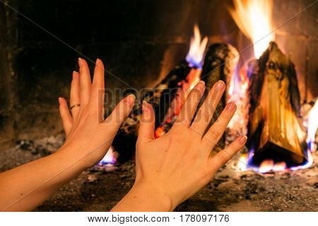 Hands warming themselves by the open fire, Sweden