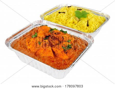 Creamy chicken tikka masala curry and pilau rice in foil take away containers isolated on a white background