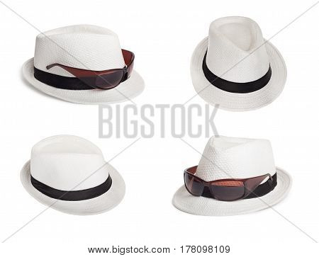 Set of sunglasses and a white summer hat on an isolated background