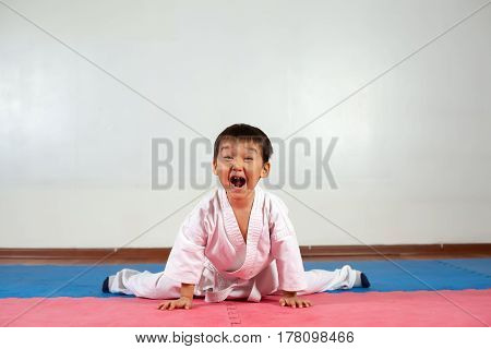 Little boy yells a battle cryFighting position active lifestyle practicing fighting techniques