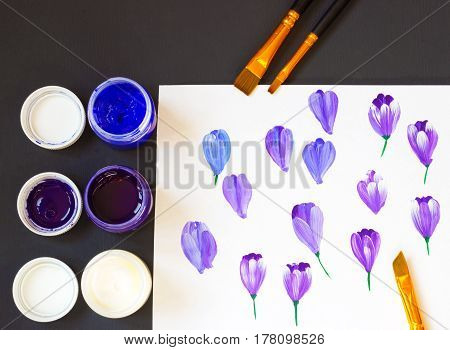 One stroke painting. Basic one stroke painting strokes explained for beginners. Three acrylic paint colors and brushes. Hand drawn folk crocus flowers, creative work place on the black table