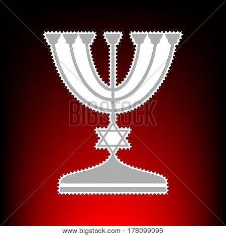 Jewish Menorah candlestick in black silhouette. Postage stamp or old photo style on red-black gradient background.