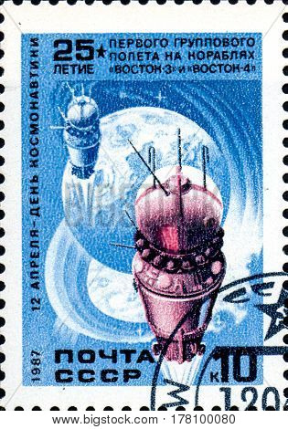 UKRAINE - CIRCA 2017: A stamp printed in the USSR shows First group flight aboard Vostok April 12 - Day of Astronautics circa 1987