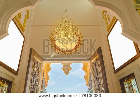 Thai temple door overlooking the sky onstruction, culture, design,