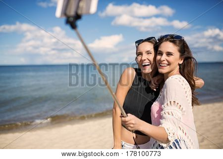 Happy Women Taking Selfie On Beach
