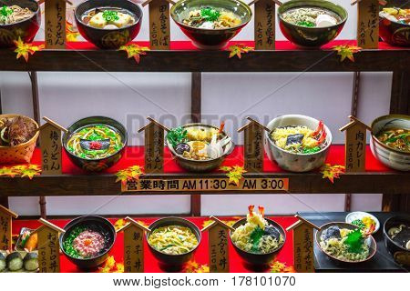 KYOTO, JAPAN - NOVEMBER 10, 2016: Restaurant window with plastic food in Kyoto, Japan. Fake food is a model or replica of a food item made from plastic, wax, resin or similar material.