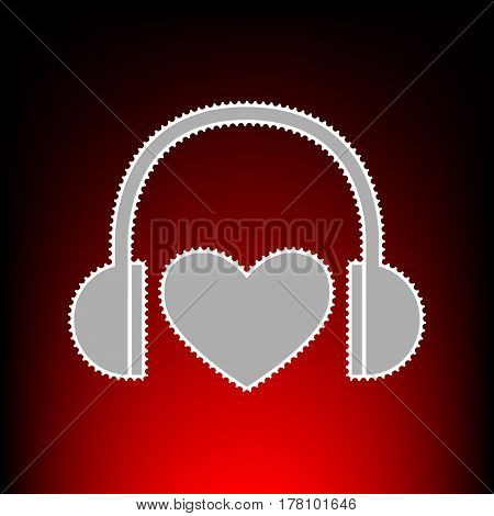 Headphones with heart. Postage stamp or old photo style on red-black gradient background.