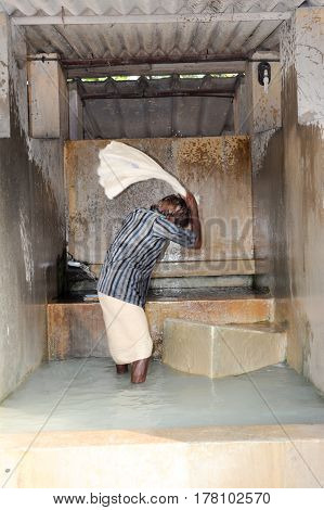 Man Washing Laundry At Fort Cochin On India