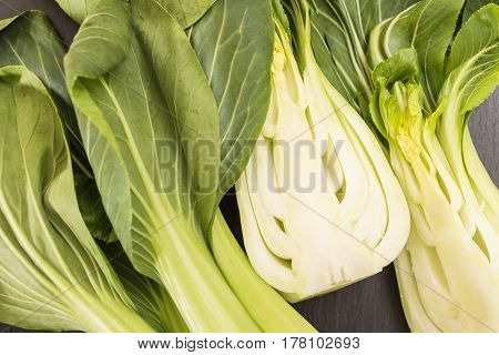 Bunch Of Fresh Green Baby Bok Choy Cut In Half Closeup