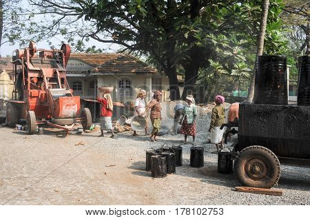 Woman Carrying Stones To Pave Roads At Fort Cochin
