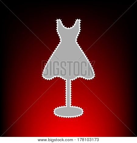 Mannequin with dress sign. Postage stamp or old photo style on red-black gradient background.