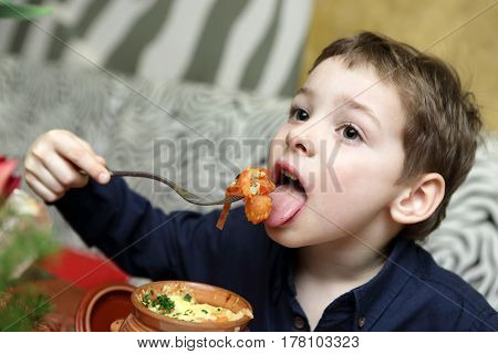 Child Eating Baked Vegetables