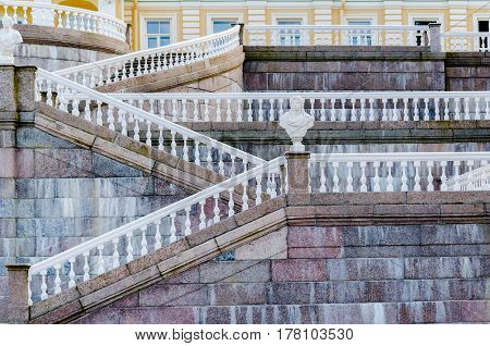 Geometric lines with white balustrades and railings on the marble stairs of the Palace in Oranienbaum