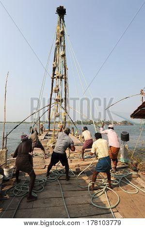 Fishermen Operate A Chinese Fishing Net