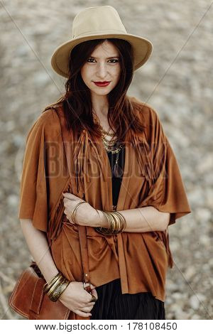 Beautiful Stylish Boho Woman With Hat, Fringe Poncho. Hipster Girl In Gypsy Look Young Traveler Posi